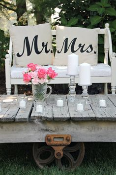 antique railroad cart and Mr and Mrs pillows