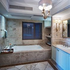 Tile from top-to-bottom in this lovely master bathroom. Check out 127 more luxury bathroom design ideas at