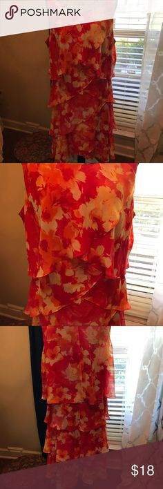 S L Fashions dress. Size 18 NWT Floral red/orange colors. Tiers to hide flaws. Beautiful dress to wear to church, work or anywhere else you would want to wear. S L Fashions Dresses