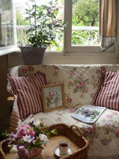 I like to cover chairs with pretty quilts, like this. Very English cottage.