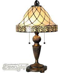 Tiffany Tafellamp Filigrees  Een bijzonder mooie tafellamp. Helemaal met de hand gemaakt van echt Tiffanyglas. Dit originele glas zorgt voor de warme uitstraling. De voet is vervaardigd van bronskleurig metaal. Met 2x grote fitting (E27). Met 2 schakelaars aan de kap. Afmetingen: Hoogte: 63 cm Diameter Kap: 36 cm