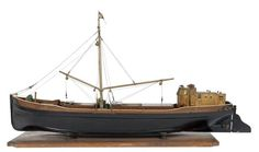 The model depicts the barge 'Convoy' (1900), originally built as a topsail coaster by G. & T. Smith of Rye, Sussex, after her conversion to power in 1944. This well-known sailing barge was only finally broken up in 2004