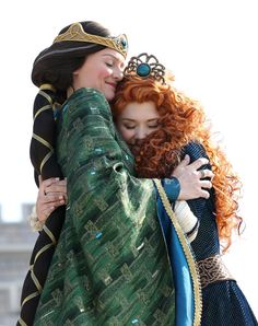 Merida hugs her Mother at her Coronation.