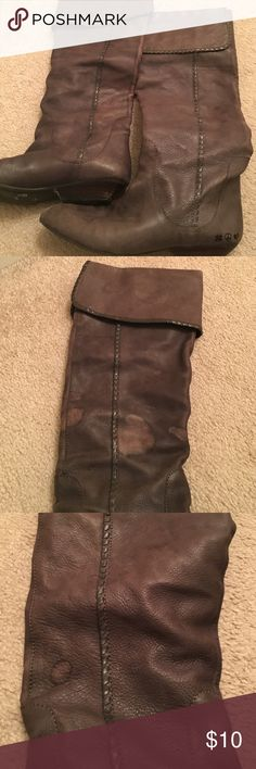 Lucky brand tall boots Worn. Water stains on the leather. See pictures. Pointy toes. Flap over the top that can be pulled all the way up. Small scuffs on the point. Lucky Brand Shoes