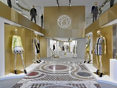 Versace opens a new boutique in Barcelona, in the store concept conceived by Donatella Versace in collaboration with the English architect Jamie Fobert. The boutique occupies an area of 720 square metres, skilfully blending the. Shop Interior Design, Retail Design, Store Design, Showroom Design, Versace Tiles, Versace Store, Clothing Displays, Barcelona, Retail Interior