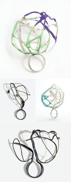 These rings are made from rubber and silver — but the rubbery black ones are blackened silver, and the ribbons of colour on silver are rubber - by Elizabeth Bailey Christenbury