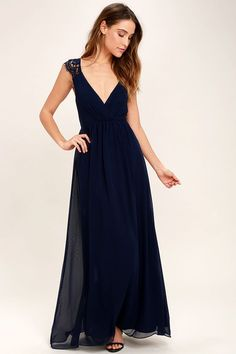 You can feel the magic in the air the moment you slip on the Whimsical Wonder Navy Blue Lace Maxi Dress! Lightweight chiffon shapes a pleated surplice bodice with lace straps. Fitted waist leads into a cascading maxi skirt. Hidden back zipper.