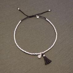 Bracelet fin strass et pompon noir Ikita 3027A