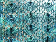 Shetland Shell.  Love this Shetland lace pattern which is totally reversible. Recommended - single colored lace yarn (silk or mohair) which would show off the pattern.  Stunning.