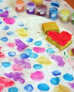 Do wrapping paper but with the prints. Show your child how to make homemade wrapping paper with a twist by using sponge art to create the fabulous designs. Here's how: