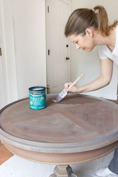 Great tips on refinishing a table including a beautiful gray stain! #diy #refinishing