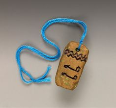 """""""While investigating pyramids and mummies, invite students to craft a replica of an amulet. This pendant gleams with symbols of Ancient Egypt!"""""""
