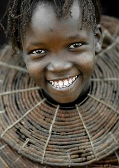 Africa |  Pokot tribe smiling girl with giant necklace - Kenya
