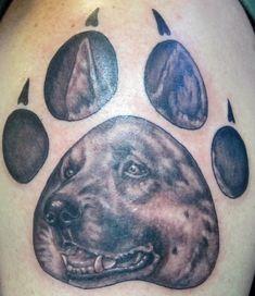 German shepherd tattoo in dogs paw