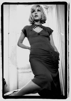 Debbie Harry, 1976. Blondie..she washed up not long after.  But still sings.  Very wide on stage...ah la Hole Cortney Love type. I like her. And she was a dark haired bleach-blonde (those dark roots hairs were STYLE