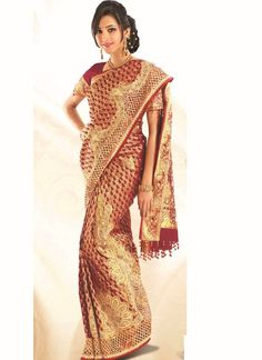 Buy Maroon brocade silk saree with rich floral design, gold embroidery and cut work Online in Michigan at best price and many more wedding sarees / bridal Saree are available Latest Indian Saree, South Indian Sarees, Indian Silk Sarees, Indian Sarees Online, Silk Sarees Online, Pure Silk Sarees, Cotton Saree, Reception Sarees, Traditional Silk Saree