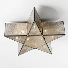 """Antiqued mercury glass mirror panels and a classic star shape create opulent drama when the light goes on! 5x15 watts candle sockets. Gold, brown and silver tones. Bronze frame. (6""""Hx18""""W) Canopy: 5""""."""