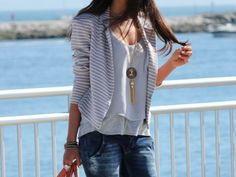 striped cardigan. pendant necklace.