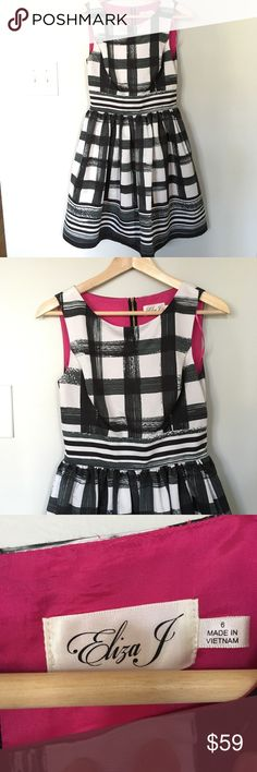 """Eliza J Windowpane Fit and Flare Dress sz 6 Eliza J Fit and Flare Dress  Size: 6  Style: Fit and Flare  Pattern: Black and White Windowpane   Measurements (taken lying flat) Chest: 16"""" Waist: 13 1/2"""" Length: 35""""  Condition: This item is new without tags. It is unworn and still has the protective sticker on the back zipper. The windowpane pattern is classic but the exposed zipper and pink detail on the back keeps it modern and flirty. Eliza J Dresses"""