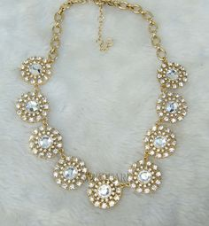 Depending on style of bridesmaid dresses, statement necklace for strapless champagne dress
