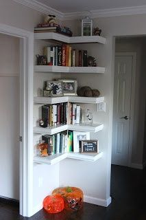 Shelves tucked into a corner. this might be the perfect thing to put in my front room behind the door as a tiny library.