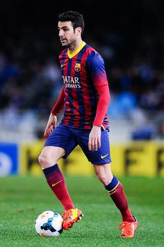 Cesc Fabregas of FC Barcelona runs with the ball during the La Liga match between Real Sociedad and FC Barcelona at Estadio Anoeta on February 22, 2014 in San Sebastian, Spain.