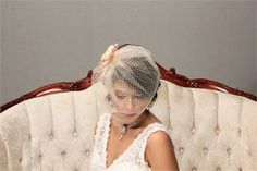 This listingis for a lovely vintage style birdcage veil and a handmade satin flower fascinator. The veil is made with 2 layers of netting -   under layer is 9 long russian netting for a retro look   over layer is made with illusion netting for a modern twist. The illusion netting part is cut slightly larger and longer for a shape and softer edge.    The veil can be made in WHITE,IVORY and CHAMPAGNE colors. it is set on to a silver tone wire hair comb. I will include 2 extra bobby pins with…