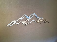 Hello, and thanks for your interest in my Aspen mountain, metal wall art. The dimensions for the listed item is 12 tall by 48 wide. This metal artwork is made by hand with aircraft aluminum that will not rust or tarnish over time. Looks great inside on walls and tile, or outside on the front of the house or fence.  Price 145.00  Bear Mountain Metal Art is based out of Fort Collins Colorado and operated by artist Bobby Singleton. Artwork is made by drawing the design out on a sheet of…