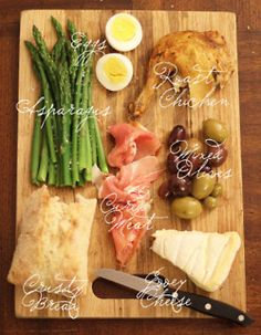 Appetizer Platter - Brie, Olives, Bread, Eggs, Roast Chicken, Asparagus and Cured Meat
