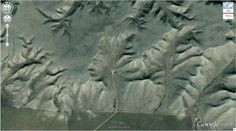 """Canada - Walsh, Alberta Known as Badlands Guardian, this human face is a valley formed in clay. (50° 0'38.20""""N 110° 6'48.32""""W)"""