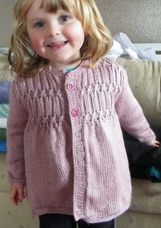 Free Knitting Pattern for Strawberry Hill Cardigan - Cardigan sweater in toddler and child sizes features a smocked yoke. Toddler's 2 (3–4, 5–6). Designed by Melissa Matthay Pictured project by RAELNE