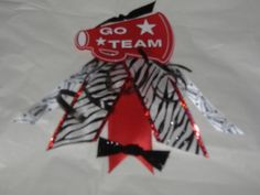 go team spirit pin Team Spirit Crafts, Cheer Locker Decorations, Cheerleading Crafts, Cheer Team Gifts, Spirit Sticks, Locker Ideas, Cheer Hair Bows, Football Cheer, Homecoming Ideas