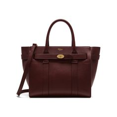 Shop the Small Zipped Bayswater in Oxblood Natural Grain Leather. The Bayswater is our most iconic bag, and its eponymous collection includes new styles inspired by the original. The Small Zipped Bayswater is the perfect option for those who like a zipped closure. Using the same construction as a Bayswater, this new style plays with the detail - deconstructing the front by removing the flap and using the iconic postman's lock to secure two belted straps.