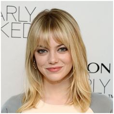 Shoulder length with blunt bangs and centre part.