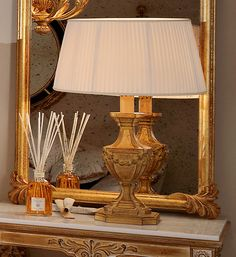 True style for any room in the house with the Louis XVIII reproduction table lamp shown here in an elaborate gold leaf finish with a pleated shade. Hand carved from beech wood to an exceptionally high standard. Can be ordered in alternative colours, finishes, sizes and shade styles. Prices will vary.