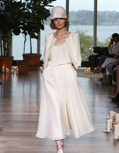 "This display of ""I Do"" fashion created a scene straight out of any wedding-lover's dream as designers pushed boundaries in these bridal fashion week trends. Fashion Week 2018, Bridal Fashion Week, 2018 Wedding Dresses Trends, Wedding Pantsuit, Wedding Officiant, Bridal Style, Dresses With Sleeves, Style Inspiration, Couture"