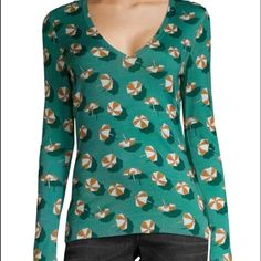 "NWT GUCCI Green Cashmere Silk V Neck Sweater NWT GUCCI Lagoon Green Cashmere Silk V Neck Sweater w/ Beach Umbrellas Sz L $650. Beautiful cashmere and silk blend v neck sweater from Gucci. Long sleeved, all over beach umbrella print design, not lined.  26"" long, sleeves are 26"" long, 18.5"" pit to pit 35% Silk 35% Cashmere 30% Wool