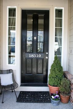 #1- I love the black door; #2 I love the handpainted street number on the door