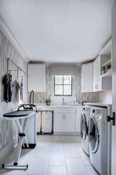 With a little effort, the laundry room can be just as stylish and organized as the rest of the house. From painted cabinetry and detailed tilework to unique hardware and storage baskets, these 30 beautiful laundry rooms offer plenty of inspired ideas for transforming your laundry room into a standout space you'll want to show off to guests.  #laundryroom #laundryroomideas #laundryroomorganization #modernlaundryroom