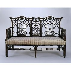 Circa 1770 Settee-- Victoria & Albert UK Collection--carved solid mahogany, in imitation of Chinese-style, w/ piercing & blind fretwork-unattributed , but associated w/ Thomas Chippendale's design books--many surviving example of 'Chinoiserie' actually  date from Later 19th C. revival (1855-1900)