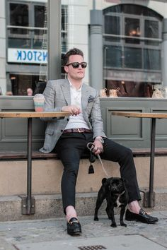 White shirt, gray sportcoat with windowpane pattern, black pants, dressy loafers, new wayfarers, dark gray pocket square and dog.