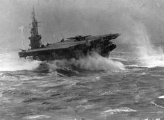 Escort Carrier HMS Searcher ploughing through rough Atlantic weather, 1943 - precarious F4F Wildcat on deck.