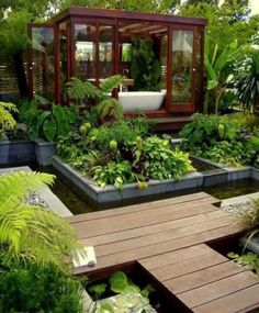 What an amazing space (backyard? rooftop?). A little teahouse-style bathing room surrounded by lush palms and a kitchen garden.