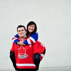 Engagement photo session in Las Vegas with hockey jerseys and urban backgrounds.