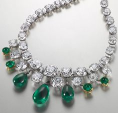 An emerald and diamond necklace mounted by Boucheron in the 1950s ~ Its eight emeralds of Colombian origin are set with a line of graduate old European and cushion-shaped diamonds.