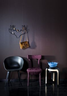 Hard to categorize- amazing purple chair, splash bowl, antler rack, and wall color.