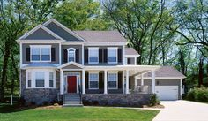 This is my dream house--the colors I want, the stone work, the porch, the carriage house garage door...Love it!!