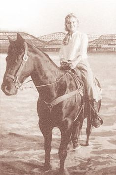 She rode a horse. Not sidesaddle. On the beach. At the Santa Monica Pier. EXCUSE ME WHILE I GO SOB.
