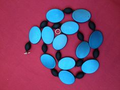 Tilted: Handmade Necklace Featuring Teal Acrylic Beads by ReprievesCorner on Etsy