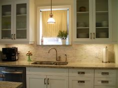Paint inside cabinets ... The Shaker-style cabinets, glass-fronted doors and pendant lights created a traditional aesthetic; they mixed in a little pop of modern styl...
